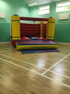 Sports Hall with a Bouncy Castle in preparation for a child's party